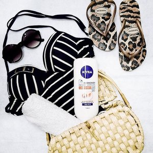 After a day of fun out in the sun & sea, I nourish my skin with NIVEA's In-Shower Body Lotion. My favourite is the Whitening In-Shower Body Lotion as it has Vitamin C so that I can have a fairer and more radiant skin glow. I love that it is a rinse-off body lotion because every part of my body gets the hydrating and whitening benefit! #NIVEAsg . . #Clozette #stylexstyle #beachlife #igsg #singapore #suncare #sgig #ootdsg #flatlay