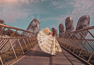 Finally managed to squeeze in this #GoldenBridge on our recent trip to Vietnam. Tip no 1, come early, reached by 7.30pm on the bridge to avoid the crowds. Tip no 2, apply sunblock all over your body! Tip no 3, purposely wear the big skirt or flowy dress to cover the group of people 😝 Tip no 4, becareful of your belonging as we lost one of our conical hat due to strong winds.. Thanks @blackivory for snapping this photo! #YuniQuetravels #YuniInVietnam #YuniInDanang #VietnamNOW #BanaHills #SunWorldBanaHills