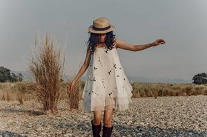 Weekends are made for frolicking through tall grasses in a white dress.