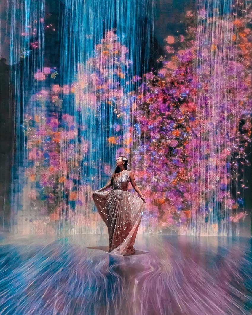 Woman in full-length dress in whimsical digital background
