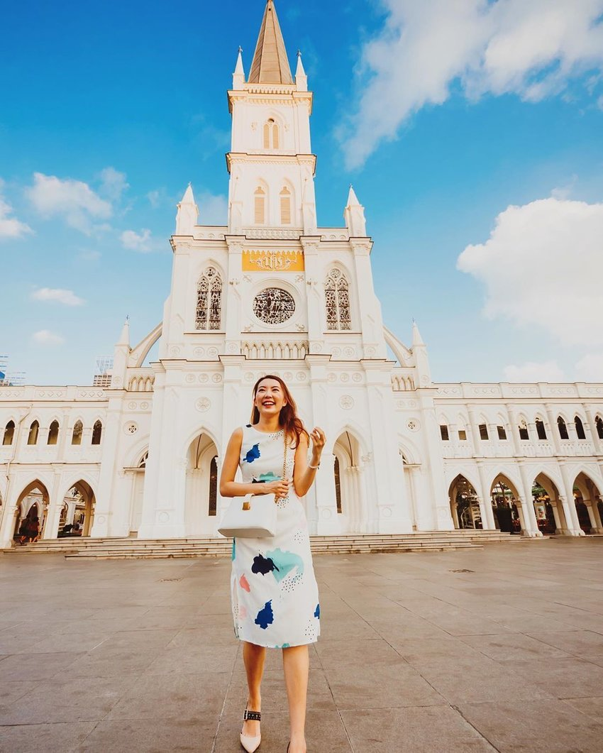 Woman posing in front of a church