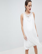 Mamalicious sleeveless lace insert woven mini dress in white